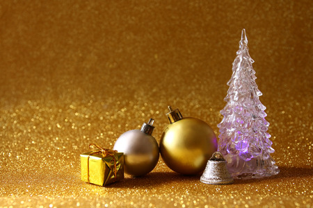 christmas tree ball: Image of christmas glowing festive tree and ball decorations on glitter background Stock Photo
