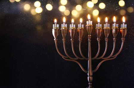 chanukiah: Low key Image of jewish holiday Hanukkah background with menorah (traditional candelabra) and burning candles