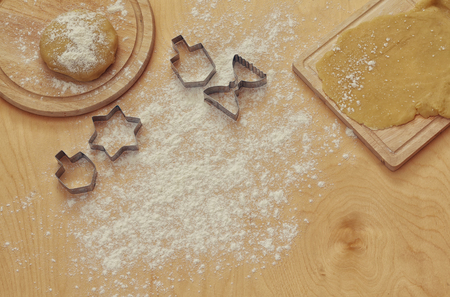 judaica: top view image of jewish holiday Hanukkah concept. Baking donuts and cookies on wooden kitchen table
