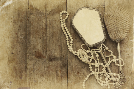 neckless: Top view image of vintage woman toilet fashion objects on old wooden table. Sepia antique style filtered photo