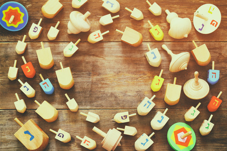 hanuka: Image of jewish holiday Hanukkah with wooden dreidels colection (spinning top) on the table Stock Photo
