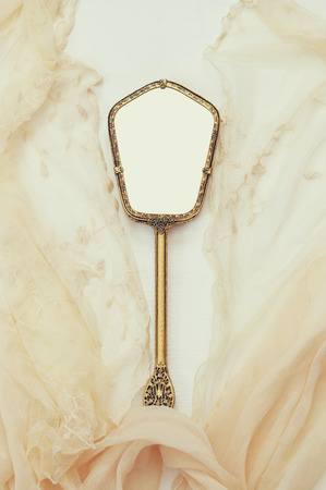 hand mirror: Top view image of vintage hand mirror and lace scarf on white background. Can be used for photography montage Stock Photo