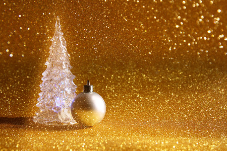 gold christmas decorations: Image of christmas glowing festive tree and ball decoration on glitter background