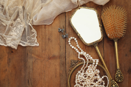 view an elegant wardrobe: Top view image of vintage woman toilet fashion objects on old wooden table