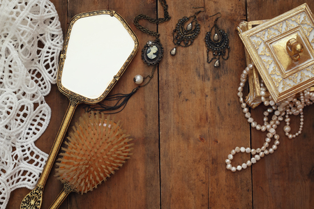 view an elegant wardrobe: Top view image of vintage woman toilet fashion objects on wooden table