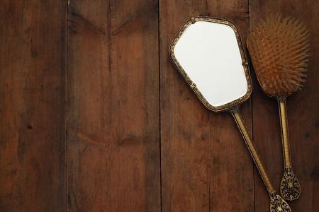 view an elegant wardrobe: Top view image of vintage woman toilet accessory on wooden table Stock Photo