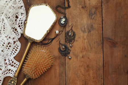 neckless: Top view image of vintage woman toilet fashion objects on wooden table