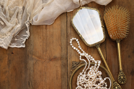 neckless: Top view image of vintage woman toilet fashion objects on old wooden table