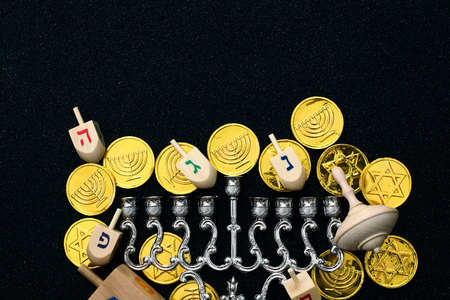 hanukka: Top view Image of jewish holiday Hanukkah with wooden dreidels colection (spinning top)