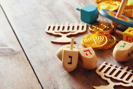 hanukiah: Image of jewish holiday Hanukkah with wooden dreidels colection (spinning top) and chocolate coins Stock Photo