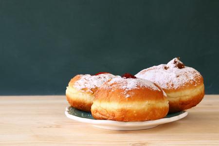 chanukiah: image of jewish holiday Hanukkah with donuts.