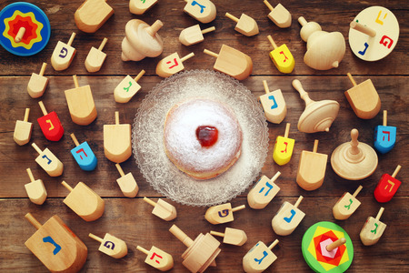 dreidels: Image of jewish holiday Hanukkah with wooden dreidels colection (spinning top) on the table Stock Photo