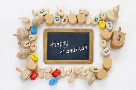 dreidels: Image of jewish holiday Hanukkah with wooden dreidels (spinning top) Stock Photo