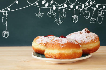 judaica: image of jewish holiday Hanukkah with donuts.