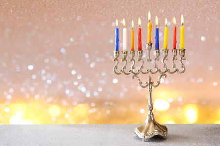 hanukka: Image of jewish holiday Hanukkah background with menorah (traditional candelabra) and burning candles