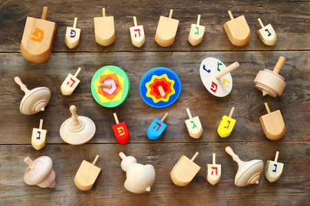 hanukka: Image of jewish holiday Hanukkah with wooden dreidels colection (spinning top) on the table Stock Photo