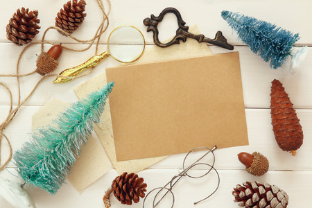 christmas objects: Top view of pine cones, christmas tree and vintage objects on white wooden background