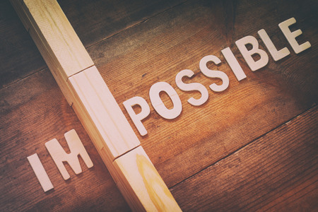 achievable: Image of wall between of the letters IM from the word impossible so it says possible. retro filter