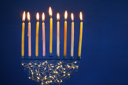 hanukah: Low key Image of jewish holiday Hanukkah background with menorah (traditional candelabra) and burning candles