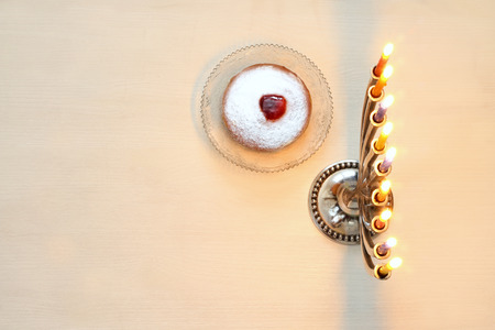 hanuka: Top view Image of jewish holiday Hanukkah with menorah (traditional Candelabra). Selective focus Stock Photo