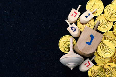 spinning top: Image of jewish holiday Hanukkah with wooden dreidels colection (spinning top) and chocolate coins Stock Photo