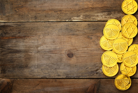 hanukka: Image of jewish holiday Hanukkah with traditional chocolate coins on the table