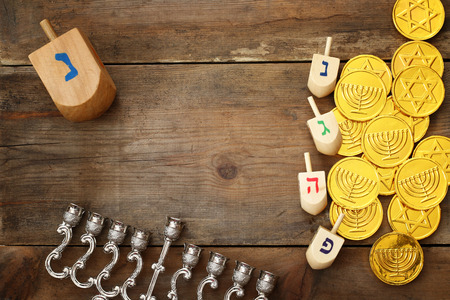 dreidels: Top view Image of jewish holiday Hanukkah with wooden dreidels colection (spinning top)