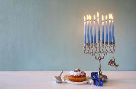 channukah: Image of jewish holiday Hanukkah with menorah (traditional Candelabra)