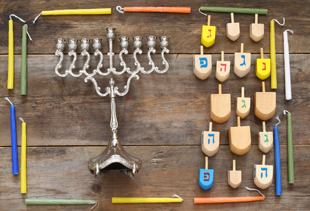 Image of jewish holiday Hanukkah with menorah (traditional Candelabra) and wooden dreidel (spinning top). Retro filtered