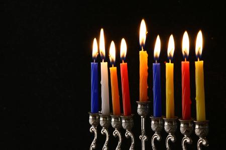 hanukka: Low key Image of jewish holiday Hanukkah background with menorah (traditional candelabra) and burning candles