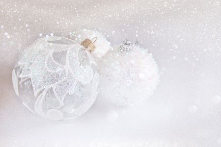 christmas tree ball: Image of christmas festive tree white ball decoration in front of silver glitter background Stock Photo