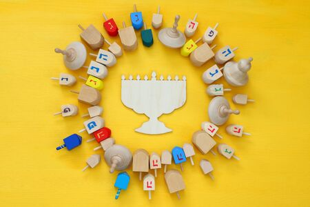 Image of jewish holiday Hanukkah with wooden dreidels (spinning top) Stock Photo
