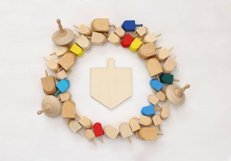 hanukah: Image of jewish holiday Hanukkah with wooden dreidels (spinning top) Stock Photo