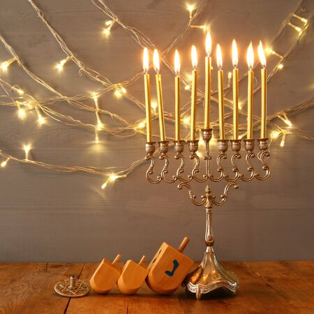 Low key Image of jewish holiday Hanukkah with menorah (traditional Candelabra)