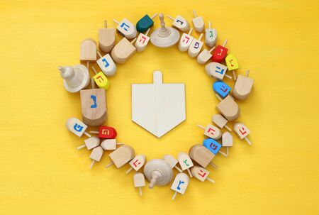 spinning top: Image of jewish holiday Hanukkah with wooden dreidels (spinning top) Stock Photo