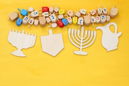 trompo de madera: Image of jewish holiday Hanukkah with wooden dreidels (spinning top) Foto de archivo
