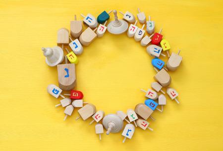 hanuka: Image of jewish holiday Hanukkah with wooden dreidels (spinning top) Stock Photo