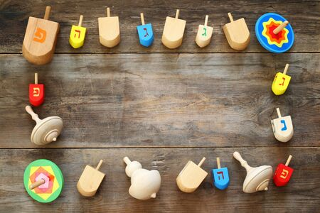 spinning top: Image of jewish holiday Hanukkah with wooden dreidel (spinning top) Stock Photo