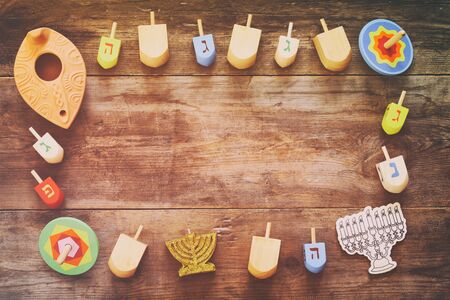 channukah: Image of jewish holiday Hanukkah with wooden dreidels (spinning top) Stock Photo