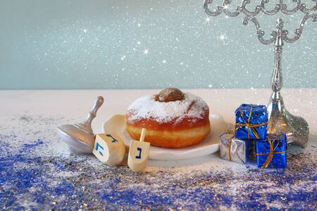 spinning top: Image of jewish holiday Hanukkah, donut and wooden dreidel (spinning top)