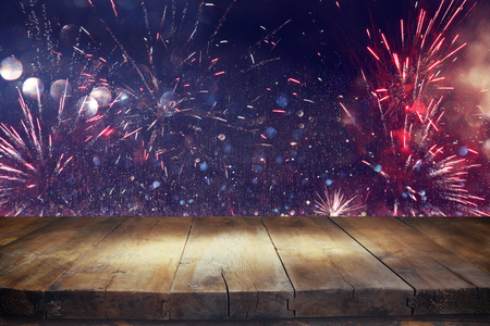 empty table: Empty wooden table in front of fireworks background. Product display montage Stock Photo