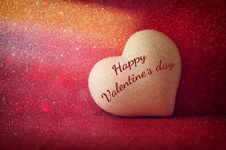 heart background: Valentines day background. Heart on red shiny background Stock Photo