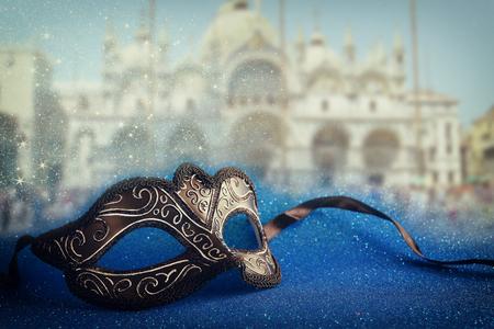 venice mask: Image of elegant venetian mask in front of blurry Venice background. Glitter overlay