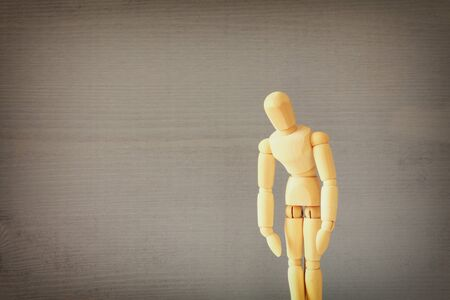compulsive: image of wooden dummy with worried stressed body position. depression, obsessive compulsive, adhd, anxiety disorders concept  Stock Photo