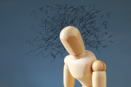 ocd: image of wooden dummy  with worried stressed thoughts. depression, obsessive compulsive, adhd, anxiety disorders concept