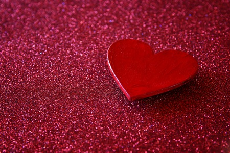 shiny: Valentines day background. Wooden red hearts on red shiny background