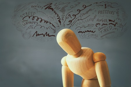 compulsive: image of wooden dummy with worried stressed thoughts. depression, obsessive compulsive, adhd, anxiety disorders concept Stock Photo