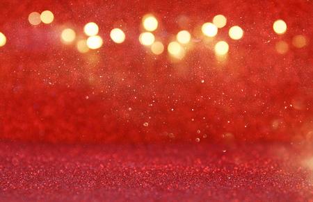 metalic texture: Red glitter vintage lights background. defocused.