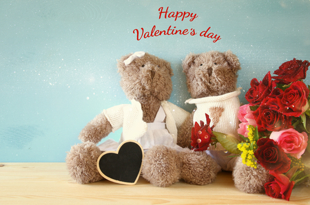 osos de peluche: Valentines day concept. Couple of cute teddy bears sitting on wooden table