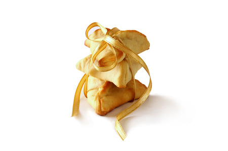 hamantaschen: Purim celebration concept (jewish carnival holiday). Traditional cookie isolated on white